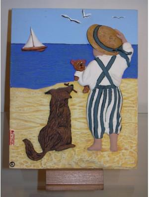Placa Niño con Perro mirando al Mar